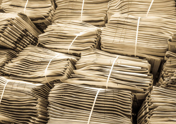 newspaper stack newspaper stacks at a sidewalk news stand stock pictures, royalty-free photos & images