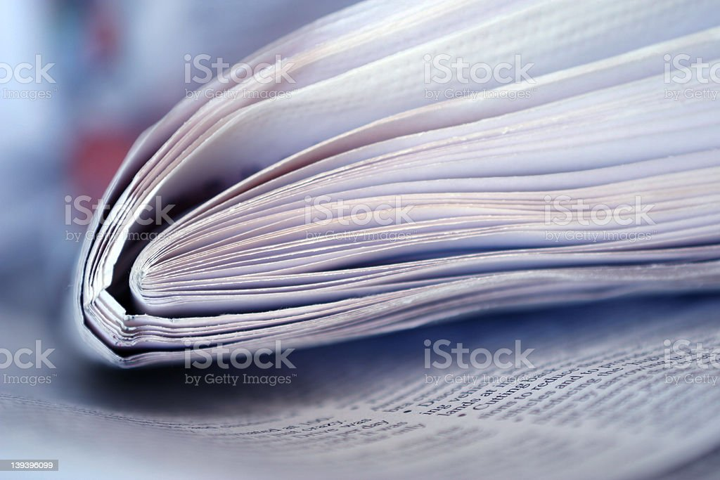 Newspaper Thrown On The Table royalty-free stock photo