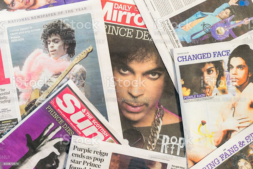 Newspaper tributes to Prince following his passing Edinburgh, UK - April 22, 2016: A selection of British newspapers featuring the musician Prince, following news of his death on April 21, 2016. Born in Minneapolis in 1958, Prince received widespread appreciation for his musical innovation and skill, as well as his commercial success.  Accidents and Disasters Stock Photo