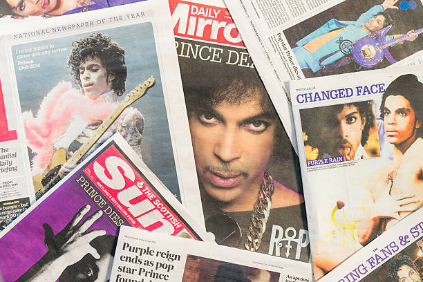 Newspaper tributes to Prince following his passing Edinburgh, UK - April 22, 2016: A selection of British newspapers featuring the musician Prince, following news of his death on April 21, 2016. Born in Minneapolis in 1958, Prince received widespread appreciation for his musical innovation and skill, as well as his commercial success.  prince musician stock pictures, royalty-free photos & images
