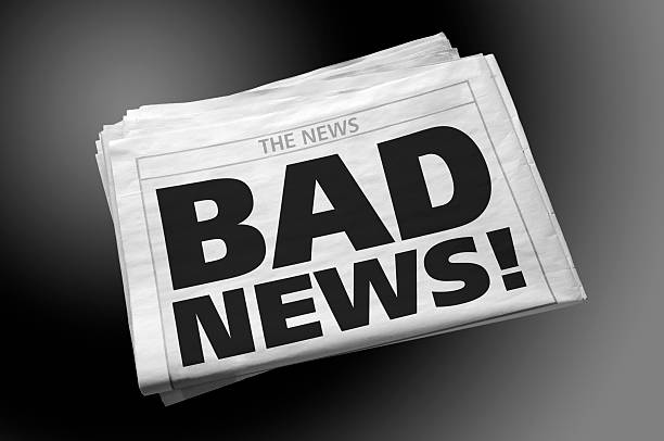Newspaper with BAD NEWS headline on first page, gradient background Pile of newspapers with BAD NEWS! headline on the first page, isolated on gradient background. Clipping path included for newspaper, directly above. newspaper cutouts of bad news headlines stock pictures, royalty-free photos & images