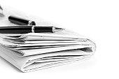 istock newspaper with ballpen 154954219