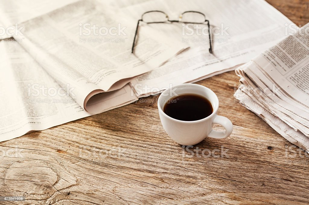 Newspaper with coffee on table stock photo