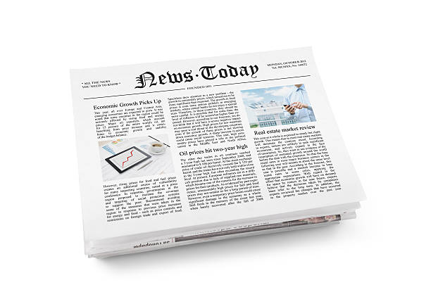 Newspaper with fresh news A stack of newspapers with headline