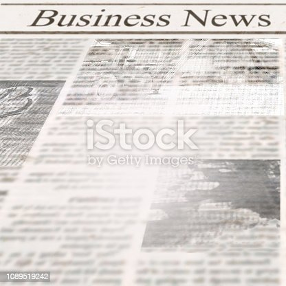 istock Newspaper with headline Business News and old unreadable text 1089519242