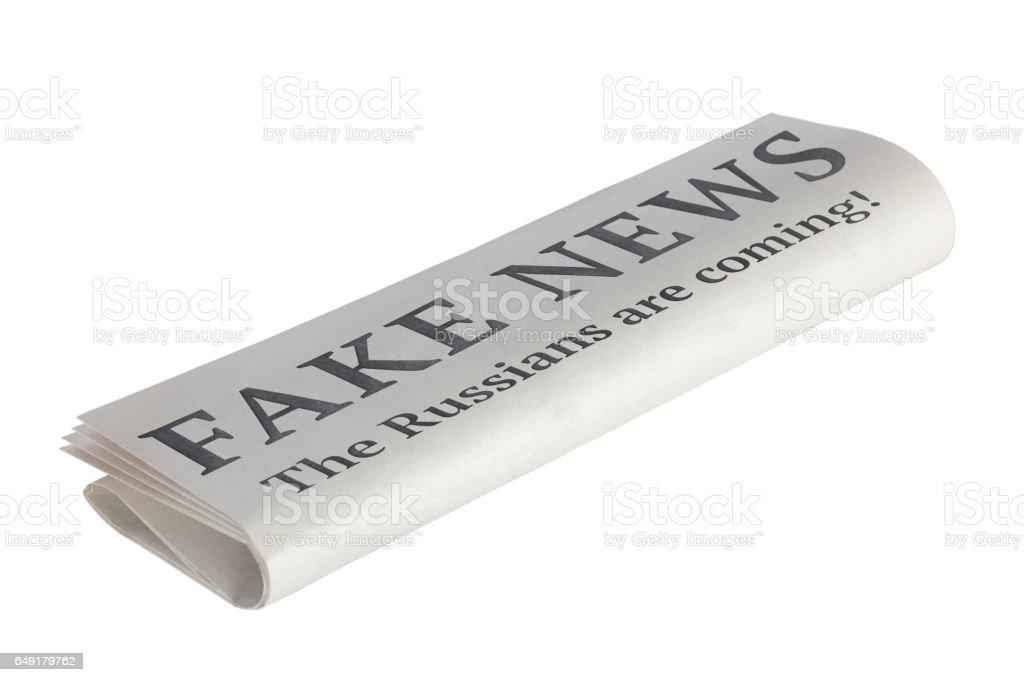 Newspaper with Headline of Fake News stock photo