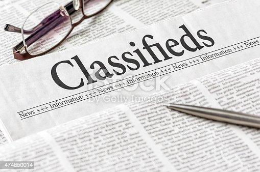 1070355804 istock photo Newspaper with the headline Classifieds 474850014