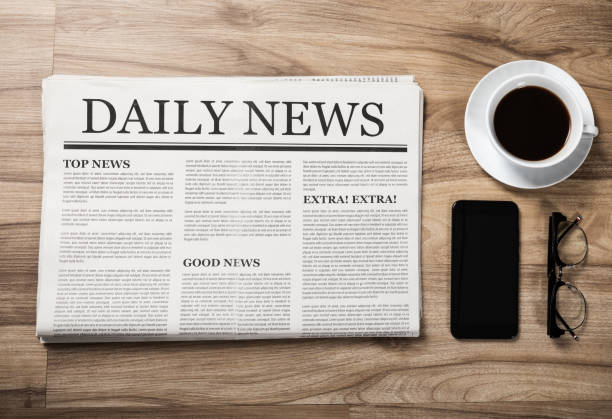 Newspaper with the headline News and glasses and coffee cup on wooden table, Daily Newspaper mock-up concept Newspaper with the headline News and glasses and coffee cup on wooden table, Daily Newspaper mock-up concept newsletter stock pictures, royalty-free photos & images