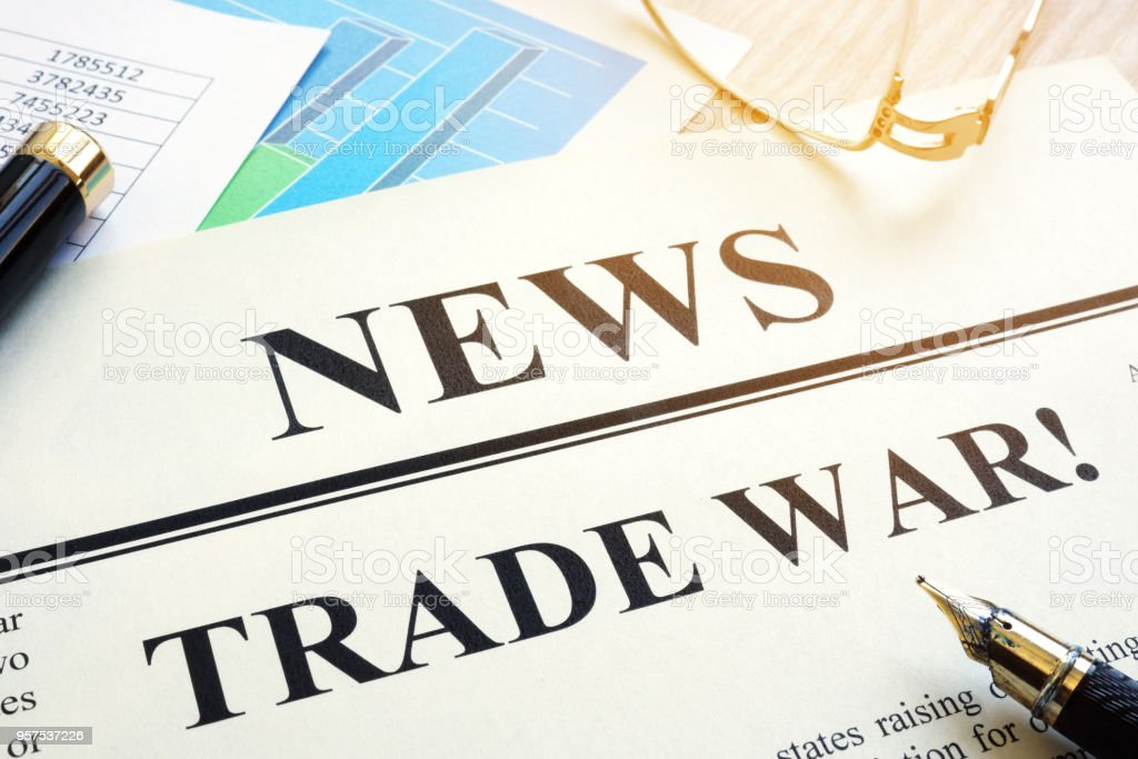 Newspaper with title Trade war on a desk. stock photo