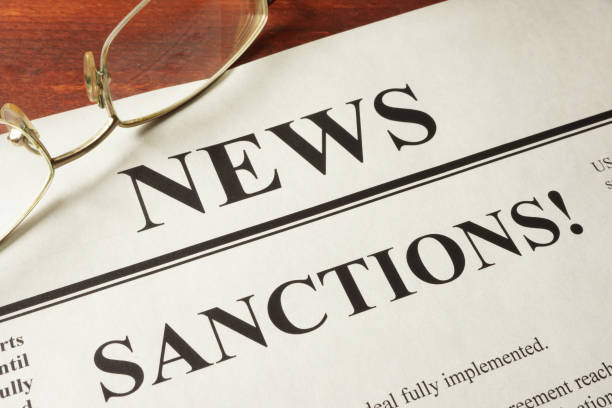 Newspaper with word news and sanctions. Newspaper with word news and sanctions. sanctions stock pictures, royalty-free photos & images