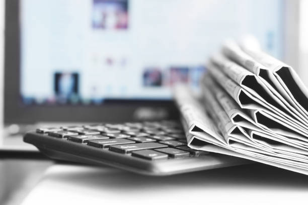 newspapers and laptop - publication stock pictures, royalty-free photos & images