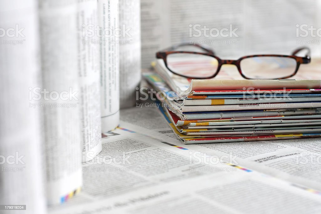 Newspapers and magazines blurred background royalty-free stock photo