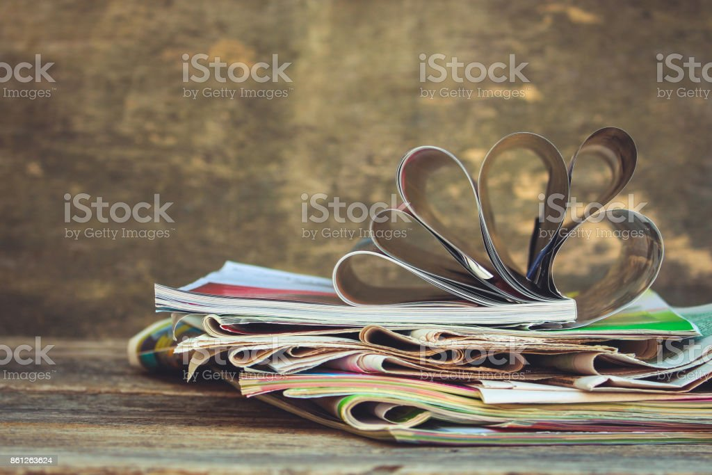 Newspapers and magazines on old wood background. Toned image stock photo