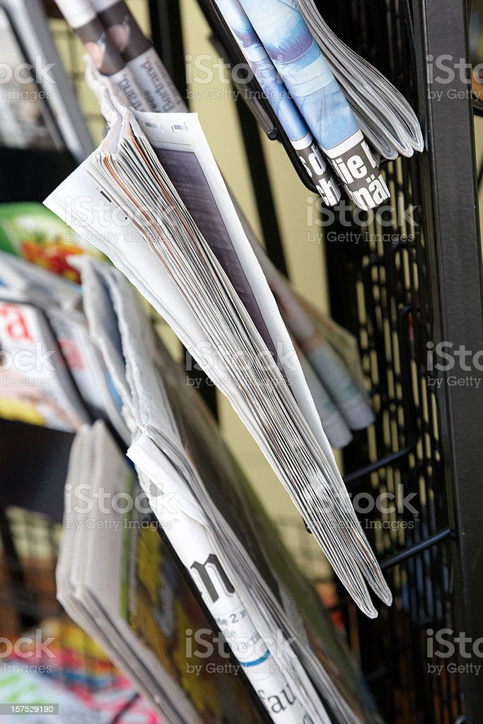 Newspapers and magazines on rack royalty-free stock photo