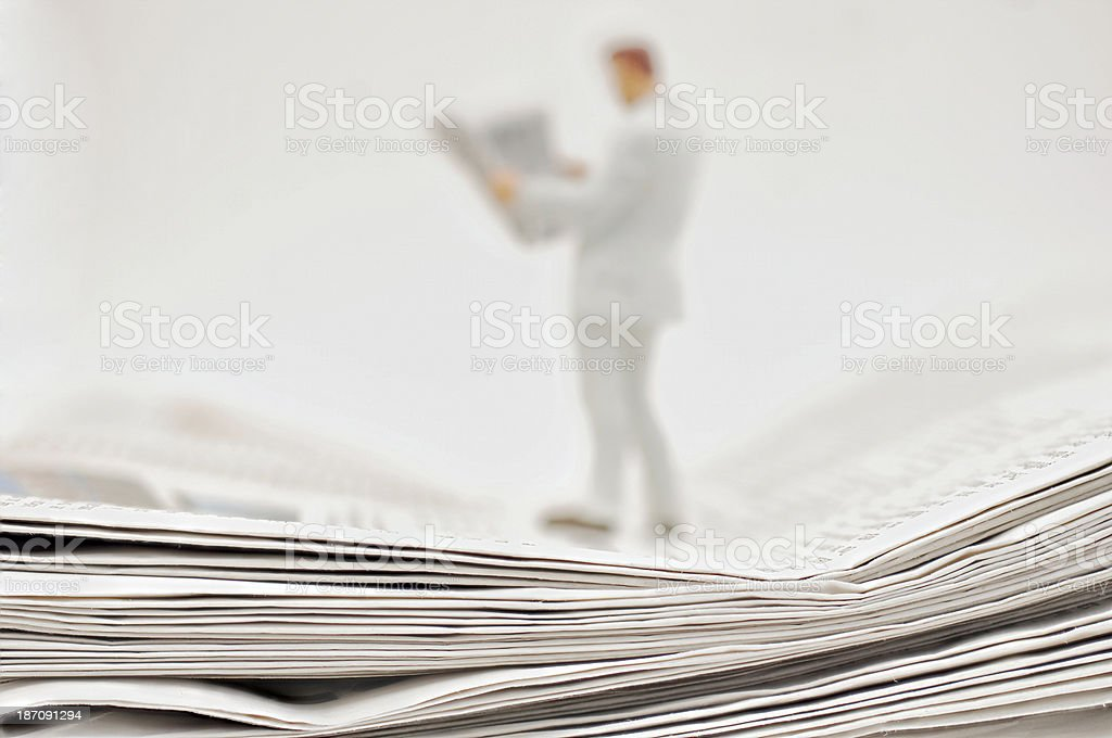 Newspapers and reader stock photo