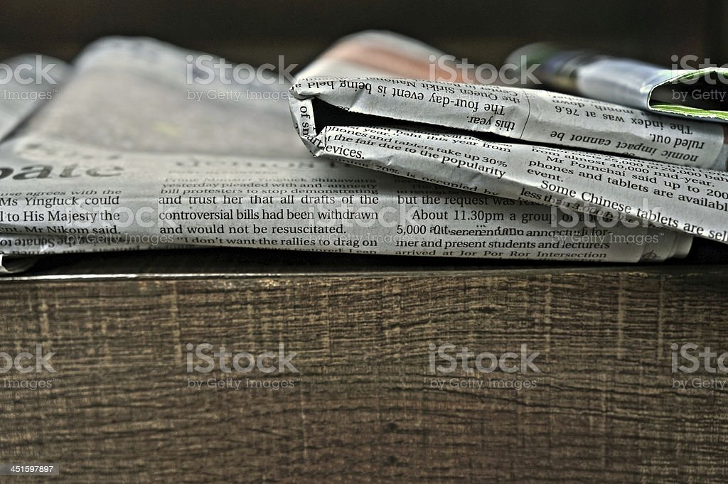 Newspapers folded and stacked concept for global communications stock photo