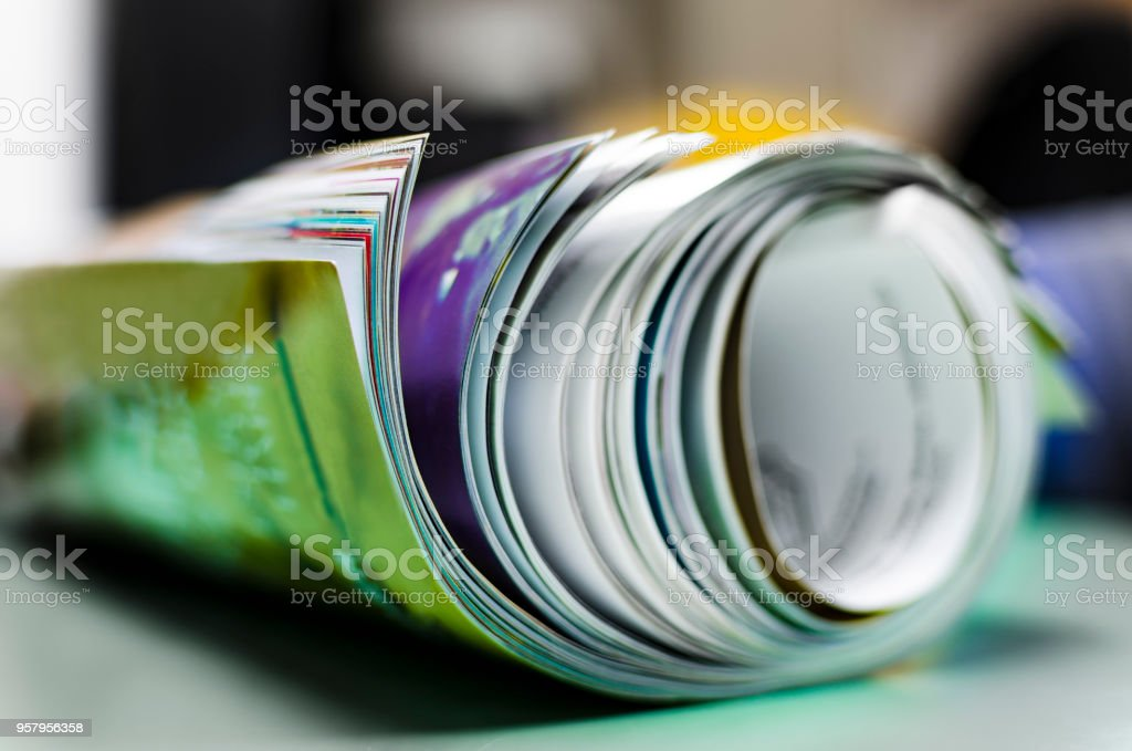 Newspapers folded and stacked stock photo