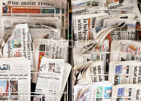 London, England - June 27, 2011: A display with international newspapers on the street, Soho, London.