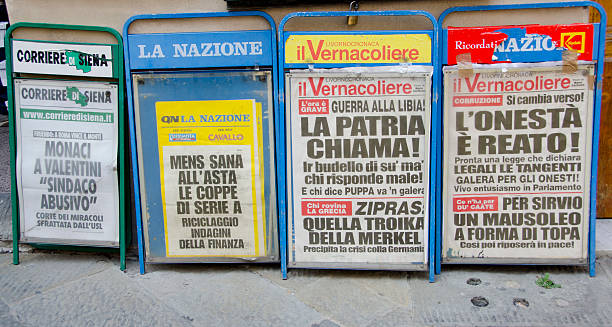 Newspapers in Siena Siena, Italy - April 16, 2015: A corner with four different newspaper stands along the Piazza del Campo in Siena showcases a range of dramatic stories from throughout the country. front page stock pictures, royalty-free photos & images