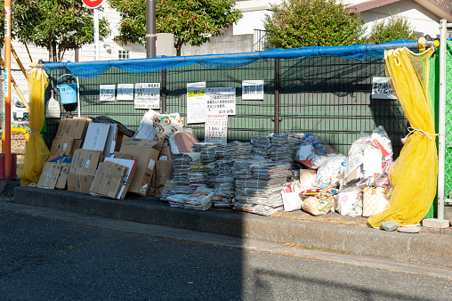 Newspapers, magazines and cardboard deposited at a collection point designated for recycling