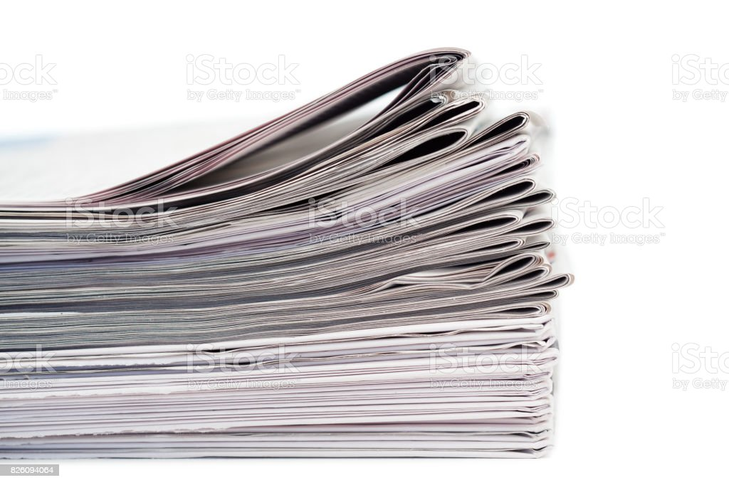 Newspapers on a white background stock photo