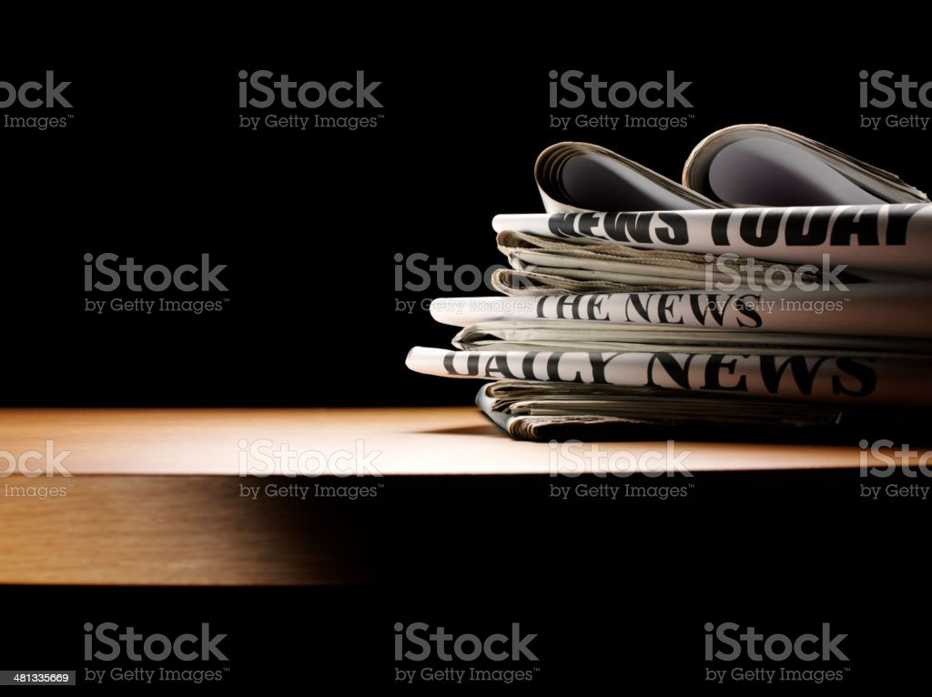 Newspapers on a Wooden Table stock photo