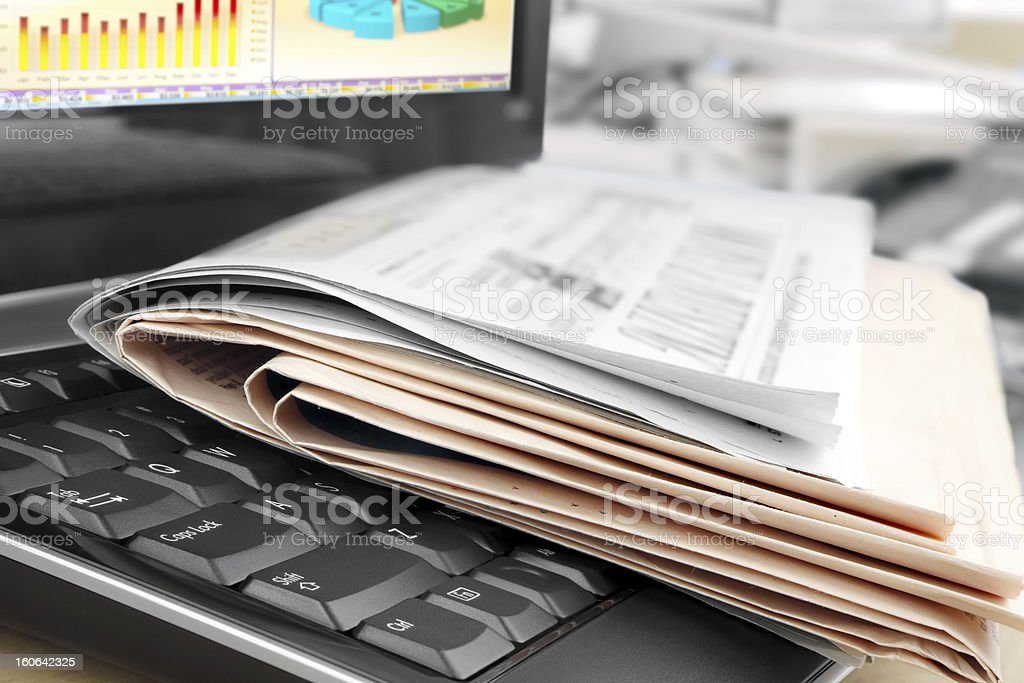 Newspapers on the Keyboard royalty-free stock photo