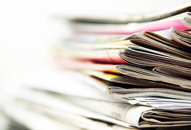 newspapers stack of newspapers news stand stock pictures, royalty-free photos & images