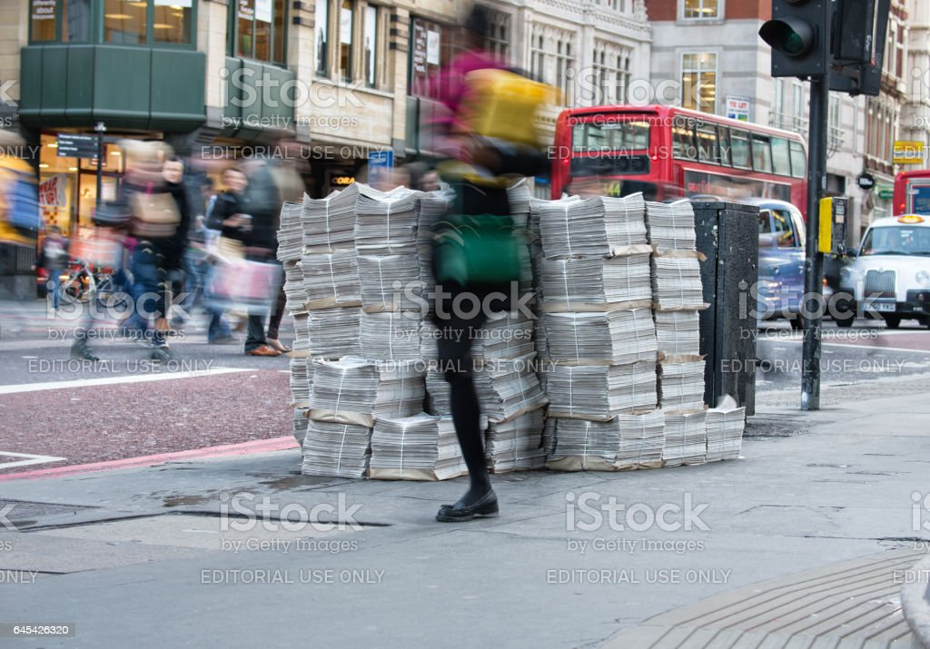 Newspapers piled up on London street stock photo