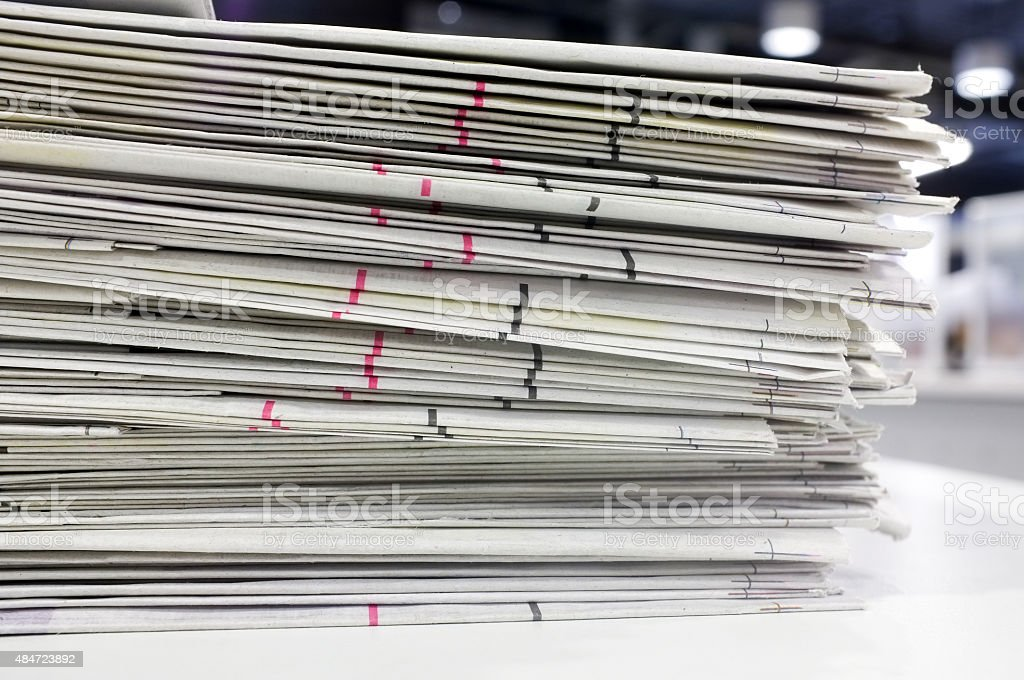 Newspapers stacked stock photo