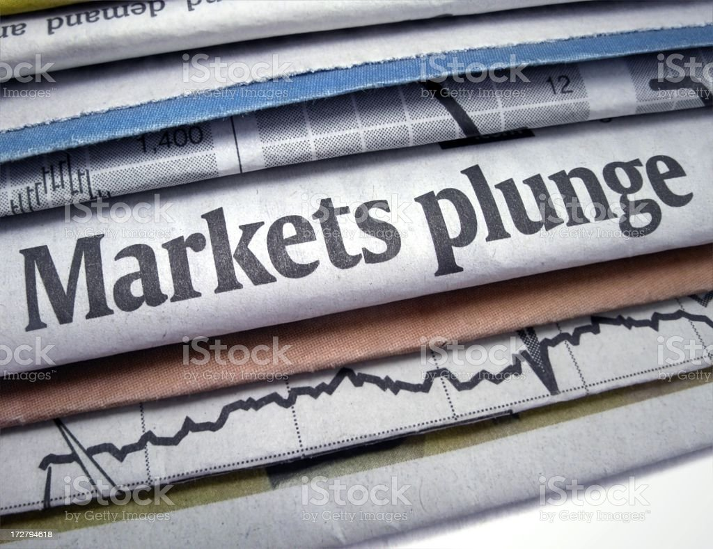 Newspapers stacked with Markets Plunge headline stock photo