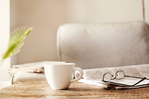 Newspapers with eyeglasses and coffee ストックフォト