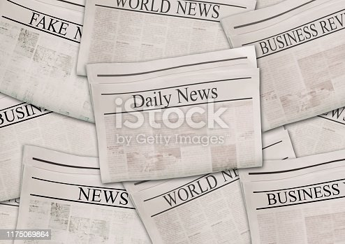 497021263 istock photo Newspapers with headlines on horizontal surface. Old newspaper background 1175069864