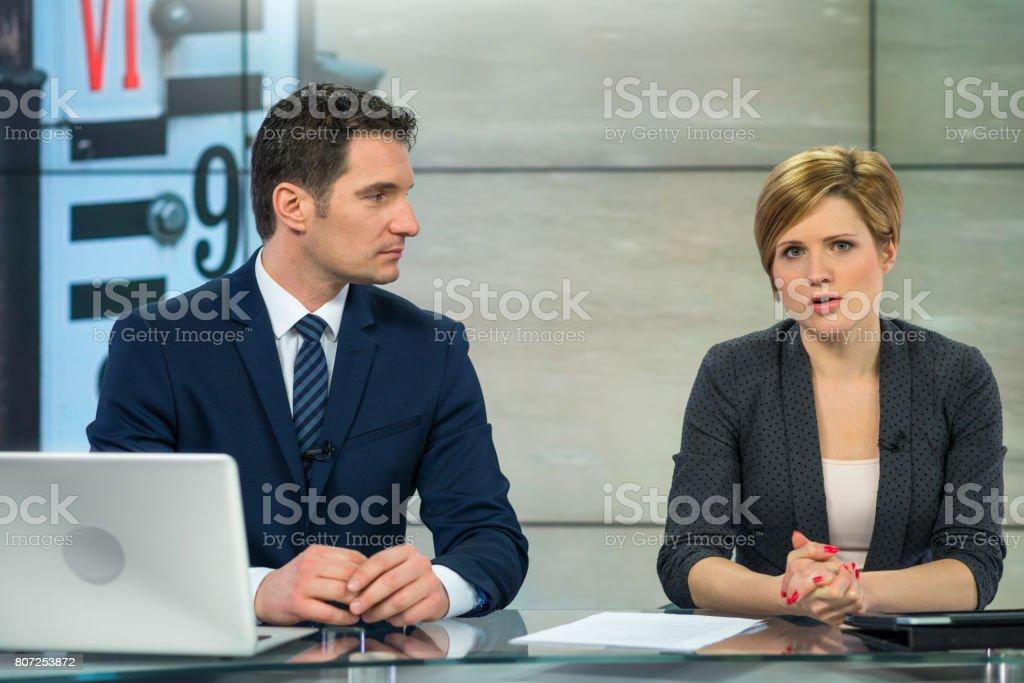 Newsreader Couple In Television Studio stock photo