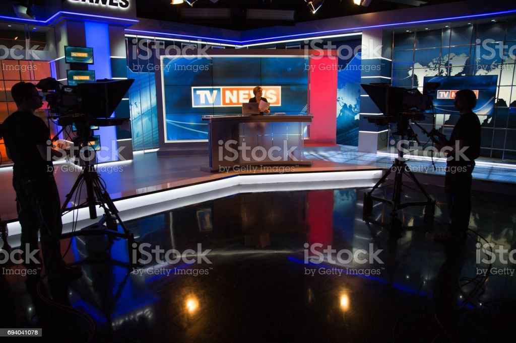 Newsreader filming in press room stock photo