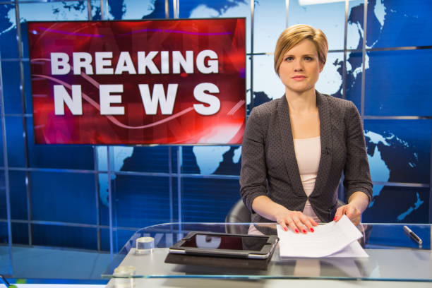 Newsreader in television studio stock photo
