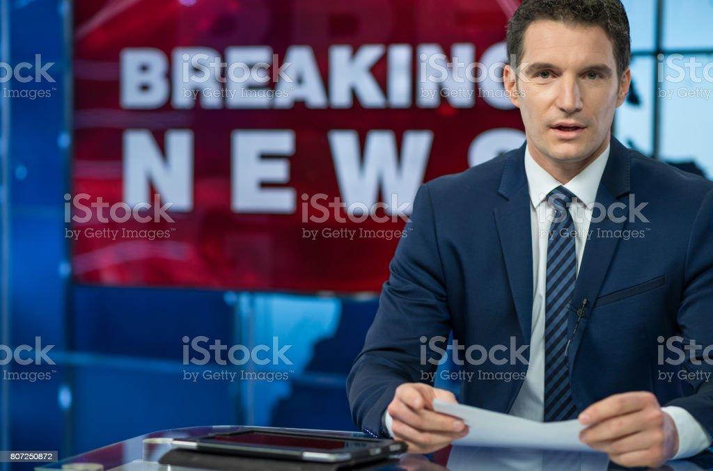 Newsreader In Television Studio stock photo