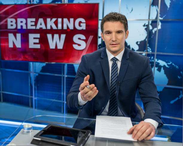 Newsreader In Television Studio Newsreader In Television Studio anchor stock pictures, royalty-free photos & images