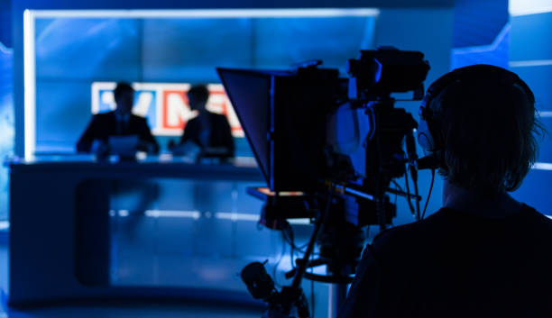 Newsreaders In Television Studio Newsreaders In Television Studio press conference stock pictures, royalty-free photos & images