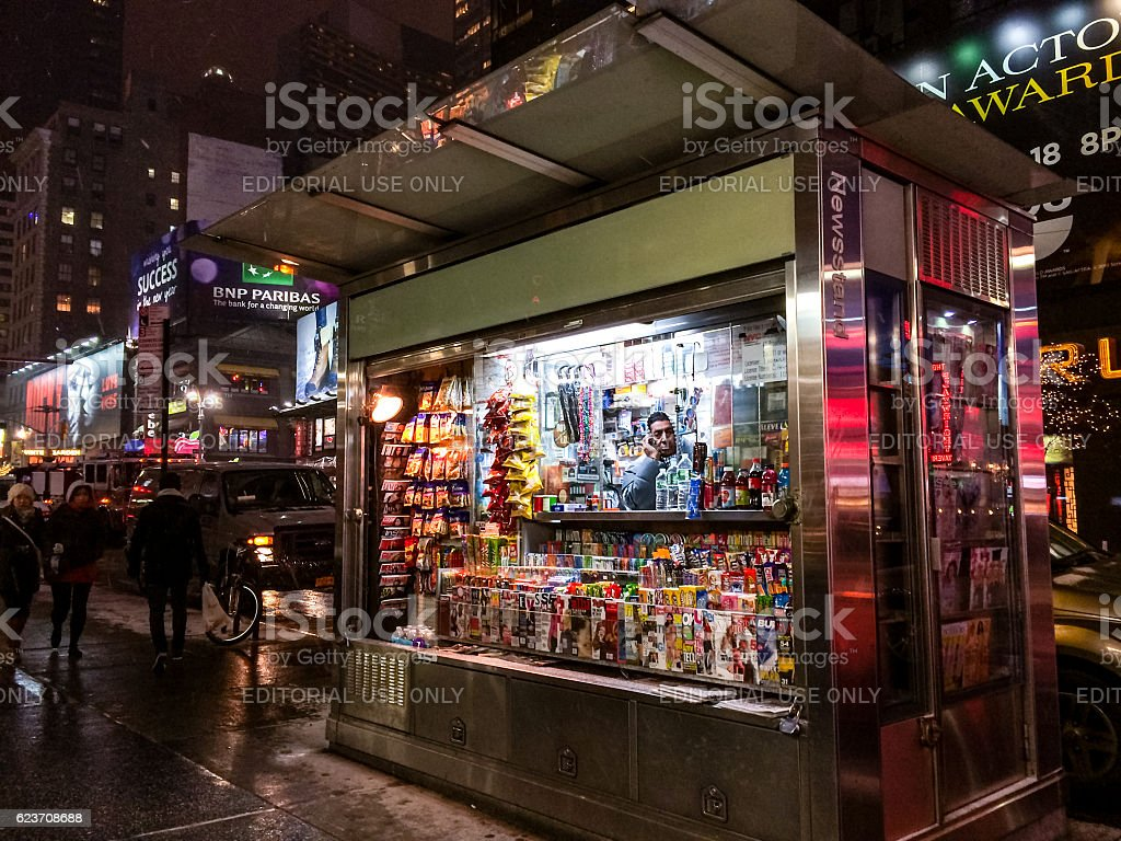 Newsstand on Manhattan with vendor and people around stock photo