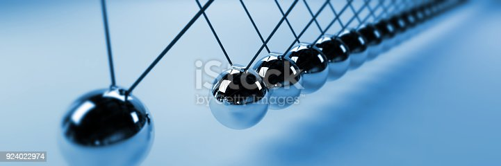 921145928 istock photo Newton cradle, cause and effect concept, blue infinity Newton's cradle, banner 924022974