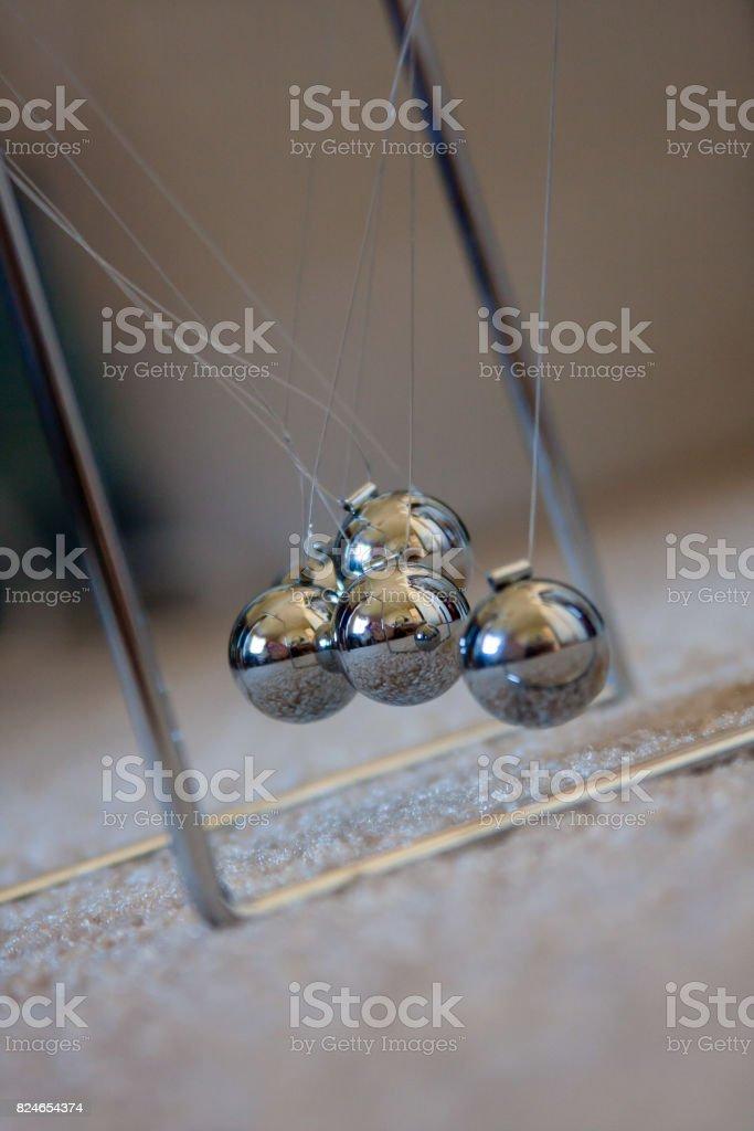 newton pendulum tangled stock photo