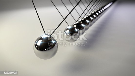 921145928 istock photo Newton's cradle, action and reaction concept, series of swinging spheres, device that demonstrates conservation of momentum and energy 1125299724