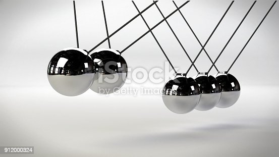 921145928 istock photo Newton's cradle, action and reaction concept with two moving balls, metal on a white background 912000324