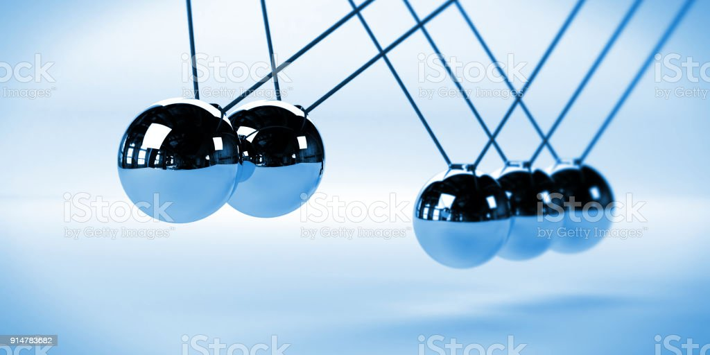 Newton's cradle, action and reaction concept with two moving balls, metal on a white background stock photo