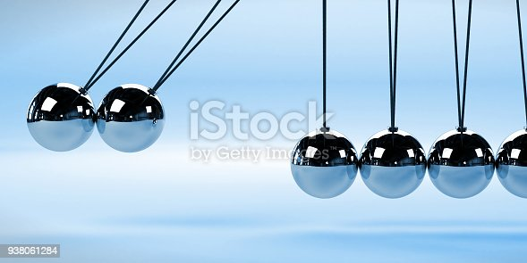 921145928 istock photo Newton's cradle, action and reaction concept with two moving balls, metal on a white background (blue 3d rendering) 938061284