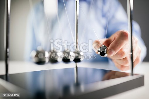 istock Newton's cradle businessman concept for cause and effect 881484124