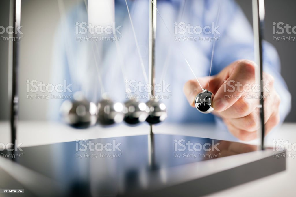 Newton's cradle businessman concept for cause and effect stock photo