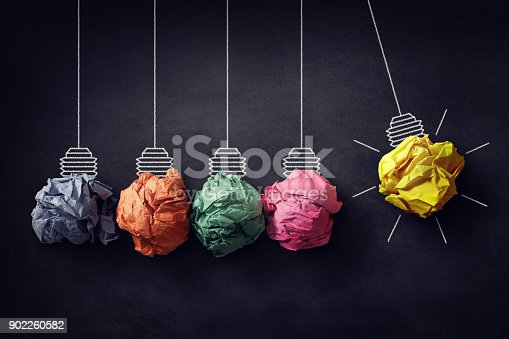 istock Newton's cradle crumpled paper bulb bright idea 902260582