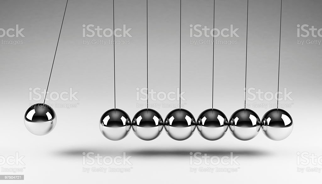 Newton's Cradle executive toy in motion stock photo